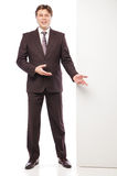 Business man holding empty board and pointing Royalty Free Stock Image