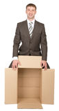 Business man holding empty box Stock Images
