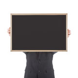 Business man holding empty chalkboard before his head Royalty Free Stock Photo