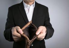 Man holding a empty wallet Royalty Free Stock Photos