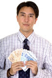 Business man holding euro notes Royalty Free Stock Photography
