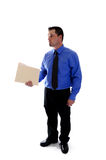Business man holding file folder. A business man in blue shirt and tie holding a file folder stock photography