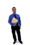 Business man holding file folder. A business man in blue shirt and tie holding a file folder looking forward royalty free stock images