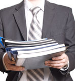Business man holding files and folders Stock Photo