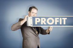 Business man holding financial profit street sign Stock Images