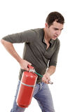 Business man holding fire extinguisher with empty Royalty Free Stock Images