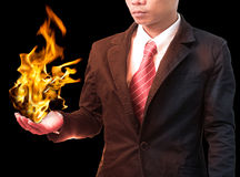 Business man holding  fire flaming on hand Stock Photo