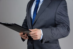 Business man holding folder with documents. Over grey background stock images