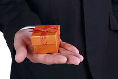Business man holding a gift box stock photography