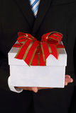 Business man holding a gift box stock image