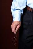 Business Man holding glasses Stock Image