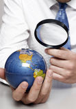 Business man holding a globe Stock Images