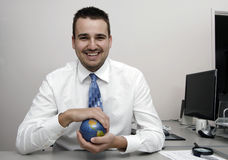 Business man holding a globe Royalty Free Stock Photo