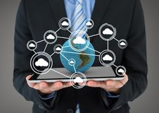 Business man holding a globe with connectors Royalty Free Stock Image