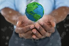 Business man holding a globe with connectors Royalty Free Stock Photography