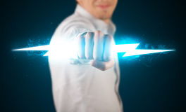 Business man holding glowing lightning bolt in his hands Royalty Free Stock Images