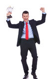 Business man holding a gold trophy Royalty Free Stock Image