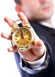 Business man holding a golden clock. Close up Royalty Free Stock Photo