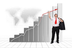 Business man holding graph arrow high up. 3d rendered image and photo combination Royalty Free Stock Photos