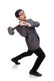 Business man holding hammer isolated on white Royalty Free Stock Photos