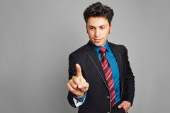 Business man holding hand to touchscreen Royalty Free Stock Photography