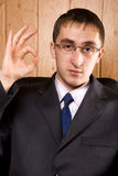 Business man holding hand up Royalty Free Stock Image