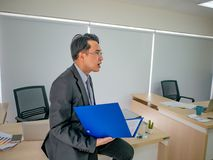 Business man holding his document sit on the table stock images