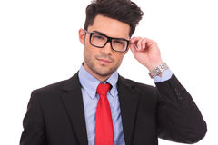 Business man holding his eyeglasses Stock Images