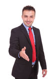 Business man holding his hand up for a handshake Royalty Free Stock Photography