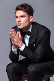 Business man holding his hands together, praying. Stock Photos