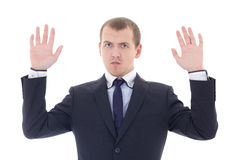 Business man holding his hands up isolated on white Royalty Free Stock Photo