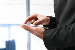 Business man holding his tablet Stock Image