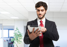 Business man holding his tablet Stock Images
