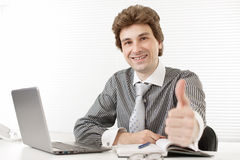 Business man holding his thumbs up Stock Images