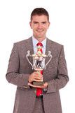 Business man holding his trophy Royalty Free Stock Image