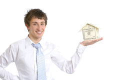 Business man holding a house made of money Royalty Free Stock Photo
