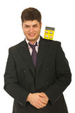 Business man holding house on shoulder Stock Photography