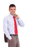 Business man holding jacket over shoulder Stock Photo