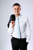 Business man holding jacket on shoulder Royalty Free Stock Images