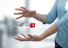 Business man holding keys. Digital composite of Business man holding keys Stock Image