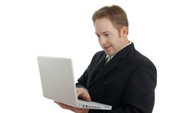 Business man holding laptop. Content, with a white background Royalty Free Stock Photo