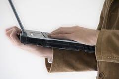 Business man holding laptop. Closeup of hands holding open laptop Stock Photos