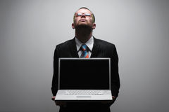 Business man holding laptop Royalty Free Stock Photo