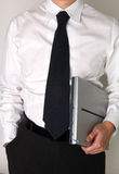 Business man holding a laptop Royalty Free Stock Photo