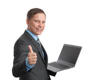 Business man holding laptop computer Stock Image