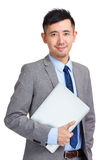 Business man holding laptop computer Royalty Free Stock Images