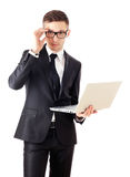Business man holding a laptop and looking surprised. Stock Image