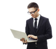 Business man holding a laptop and smiling. Stock Photography