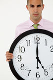 Business man holding a large clock Stock Photography