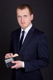 Business man holding leather purse with euro banknotes Royalty Free Stock Images